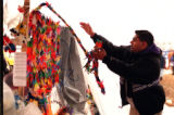 RMN137-4/23/99- Littleton, Colorado-Saikat Pal tosses a strand of Origami cranes onto a memorial...