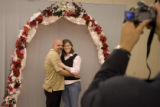 DM0214  Brandi and Michael Thelen get their picture taken under the wedding arch at the Office of...