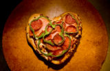 072 A heart shaped pizza is prepared at Boston's The Gourmet Pizza chain in Highlands Ranch...