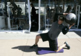 (006) Scott Podsednik works with a medicine ball for strength training during Colorado Rockies...