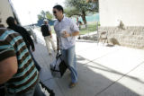 (058) Brandon Hynick carries his gear on reporting day at Colorado Rockies spring training in...