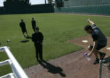 (159) Pitcher Huston Street, right, jumps onto the field, during Colorado Rockies spring training...