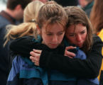 RMN133-4-22-99-Students grieve at a memorial in Clement Park for the students who were slain at...