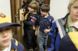 Tom Biasi, left in doorway, and Carter Morrill, right in doorway, both with  Cub Scout Pack 642...