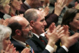 Commissioners of the Blue Ribbon Commission for Health Care Reform applaud after Chair William N....