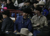 TZ Ranch owner Ty Rinaldo (c) watches other bulls during the National Western Stock Show...