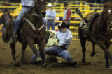 DM0502   Wes Lockard puts on the brakes as he takes down a steer during the steer wrestling of the...