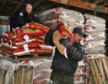 Colorado Division of Wildlife Officers (l to r)  Zach Holder (cq) and  Brent  Woodward (cq) load...