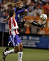 Colorado Rapids mid-fielder, Eric Denton, right, pushes the ball up field being defended by Chivas...