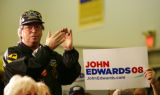 A voter applauds as Democratic presidential candidate John Edwards campaigns at the Carpenters...