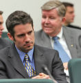 Rocky Mountain News Photographer Javier Manzano  (CQ ) sits in  front of Rep. Douglas Bruce (cq)...