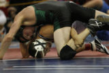 In the 135 weight class, Saul Guerrero of Ft Luton (bottom) defeats Travis Stickney of Conifer --...
