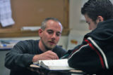 Dave Alex (cq)  , helps student Damien Cepero (cq) during a  Geometery class at  North High School...