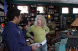 Kathy Wells (cq) talks to Dan Pabon (cq) at her home in Denver's Highlands, as Dan went...