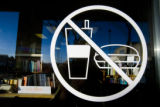 A no food or drink sign is posted on the window of Book World, 2353 S. Havana St.,Denver, Colo. on...