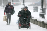 Felicia Young (cq), 28, of Denver, steers her wheelchair through the snow in City Park in Denver,...