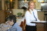 Tammy Hiatt Monaco, co-owner of the Monaco Trattoria in Loveland, steps in as a needed server for...