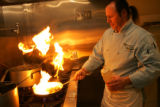 Chef/owner Giuseppe Monaco cooks up some Luingini Marechiaro, or Linguini with Clams, in the...