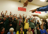 Democrats are counted as they raise their hand to vote for Mark Udall for U.S. Senate in precinct...