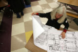 MJM039  Lila Bellamente (cq) makes maps with all the meeting locations of all 40 precincts...