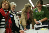 MJM115 Volunteer, Sarah Bauer (cq), right, helps ladies find out where to find their precinct as...