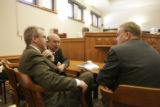 0650 The Prosecution team confers as they wait for Tim Masters to enter the courtroom courtroom at...