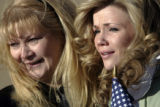 [351] Luann Covalt (cq) (left) and her daughter Gretchen Covalt (cq) cry as they look for Master...