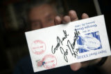 Stan Whitaker of Aurora, holds up an autograph of Joe Namath. Stan  has attended all 41 Super...