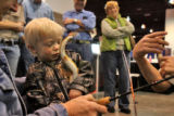L to R : Phil Jordan (cq) holds a fishing pole for his grandson , Myles Jordan (cq), age 2, as he...