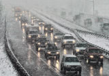 Ski traffic heads East on I-70 at Dumont Colorado Sunday afternoon March 19, 2006 during a snow...