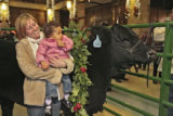 Lindsay Agnew (cq),left, and her daughter Aysha Agnew, look at Maynard, the steer, in the Brown...