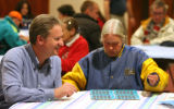 Craig Knippenberg (cq), left, helps Elizabeth (no last name permitted) play Bingo, Monday night,...