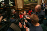 Rep. Joe Rice (cq) D- Littleton,,center, is swarmed by members of the media in  the House of...