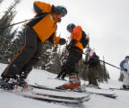 (Keystone, Colo., Feb. 9, 2008) Instructor June Terens (foreground) starts the day with a sideslip...