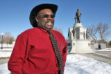 Vern Howard (cq) chief organizer of Martin Luther King Jr. holiday events, at the MLK statue in...