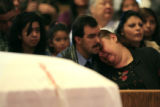 DM0536   Cayetano Armenta holds his wife Marilynn Armenta as the two mourn the death of their...