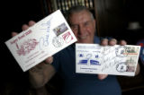 Stan Whitaker of Aurora, holds up autographs of Bill Walsh and Bart Starr. Stan  has attended all...
