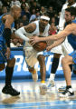 Denver Nuggets Allen Iverson splits a pair of Orlando Magic defenders in the first quarter at the...