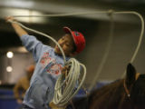 Adrian Herrera, (cq) practices his roping for Mexican Rodeo Extravaganza, Firday night, January...