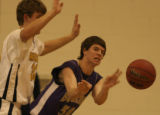 Boulder High Schools David Bremner passes the ball while being guarded by Mullen High School's...
