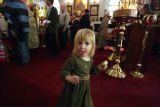Taisiya Rubtsova, 2 gets some of the communion bread during the 110th annual St Slava Celebration...