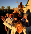 Frightmare owner Theresa Holder, cq, 42, front-center, stands with her crew outside Frightmare in...