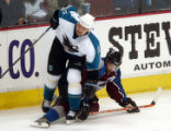 (Denver,CO,Shot On 4/28/04-- Colorado Avalanche Peter Forsberg slide between the legs of San Jose...