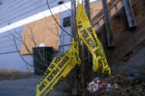 DM5493   Police tape still hangs outside the downstairs apartment at 4711 W. Tennessee Ave. in...