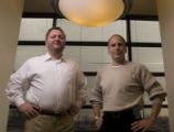 Dan Caruso (left), the President and CEO of Zayo Bandwidth poses with John Scarano (right), the...