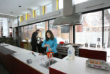Ellin Rosenthal makes breakfast in the long kitchen of her house on January 21, 2008, which won...