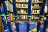 A painted chair obscures the fine collection of books at Book World, 2353 S. Havana St.,Denver,...
