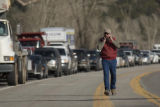 Paul Conrad photo With the afternoon traffic backing up behind him, Monroe Summers of Basalt walks...