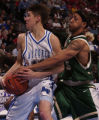 (Denver, Colo. Shot on March 11, 2004)  Colorado State Rams Dwight Boatner, right, #5, reaches for...
