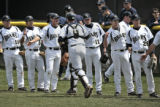 Bears catcher, Erik Whinery, slaps hands with teammates after warm-ups, before a game April 25,...